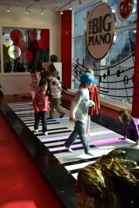 Random kids playing on the Big Piano